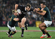 JOHANNESBURG, South Africa, 04 October 2014 : Conrad Smith of the All Blacks gets away from Jean de Villiers (C) and Jan Serfontein (right) of the Springboks during the Castle Lager Rugby Championship test match between SOUTH AFRICA and NEW ZEALAND at ELLIS PARK in Johannesburg, South Africa on 04 October 2014. <br /> The Springboks won 27-25 but the All Blacks successfully defended the 2014 Championship trophy.<br /> <br /> © Anton de Villiers / SASPA