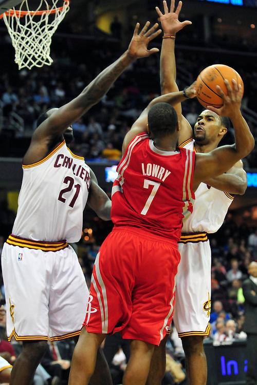 Feb. 23, 2011; Cleveland, OH, USA; Cleveland Cavaliers power forward J.J. Hickson (21) and point guard Ramon Sessions (3) try to stop Houston Rockets point guard Kyle Lowry (7) at Quicken Loans Arena. The Rockets beat the Cavaliers 124-119. Mandatory Credit: Jason Miller-US PRESSWIRE