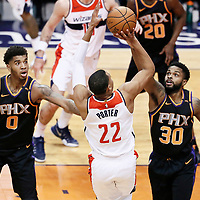 07 December 2017: Washington Wizards forward Otto Porter Jr. (22) takes a jump shot over Phoenix Suns forward Marquese Chriss (0) and Phoenix Suns guard Troy Daniels (30) during the Washington Wizards 109-99 victory over the Phoenix Suns, at the Talking Stick Resort Arena, Phoenix, Arizona, USA.