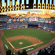 A panoramic view of Yankee Stadium as the late evening sunshine catches the Yankee Stadium facade during the New York Yankees V Baltimore Orioles American League Division Series play-off decider at Yankee Stadium, The Bronx, New York. 12th October 2012. Photo Tim Clayton