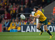Twickenham, Great Britain,  Matt GITEAu, passing the ball, during the Pool A game, Australia vs Wales.  2015 Rugby World Cup,  Venue, Twickenham Stadium, Surrey, ENGLAND.  Saturday  10/10/2015.   [Mandatory Credit; Peter Spurrier/Intersport-images]