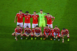 CARDIFF, WALES - Saturday, September 2, 2017: Wales players line-up for a team group photograph before the 2018 FIFA World Cup Qualifying Group D match between Wales and Austria at the Cardiff City Stadium. Back row L-R: Sam Vokes, captain Ashley Williams, James Chester, goalkeeper Wayne Hennessey, Tom Lawrence. Front row L-R: David Edwards, Chris Gunter, Ben Davies, Ashley 'Jazz' Richards, Aaron Ramsey, Gareth Bale. (Pic by Lynne Cameron/Propaganda)