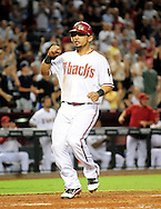 Sep. 20 2011; Phoenix, AZ, USA; Arizona Diamondbacks outfielder Gerardo Parra (8) celebrates as he crosses home plate during the seventh  inning against the Pittsburgh Pirates at Chase Field. Mandatory Credit: Jennifer Stewart-US PRESSWIRE