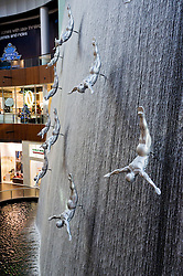 Sculptures in waterfall at Dubai Mall in Dubai in United Arab Emirates