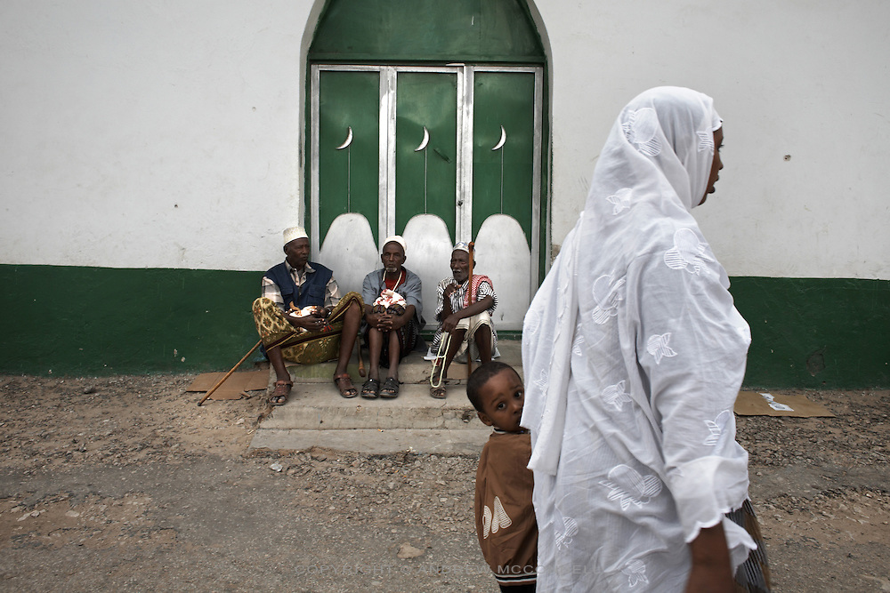 Men relax outside a mosque in Hargeisa, Somaliland.