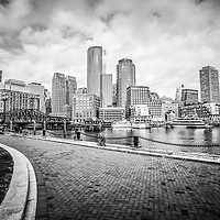 Boston Skyline harborwalk black and white picture with Rowes Wharf, downtown Boston skyscrapers and Nothern Avenue Bridge.