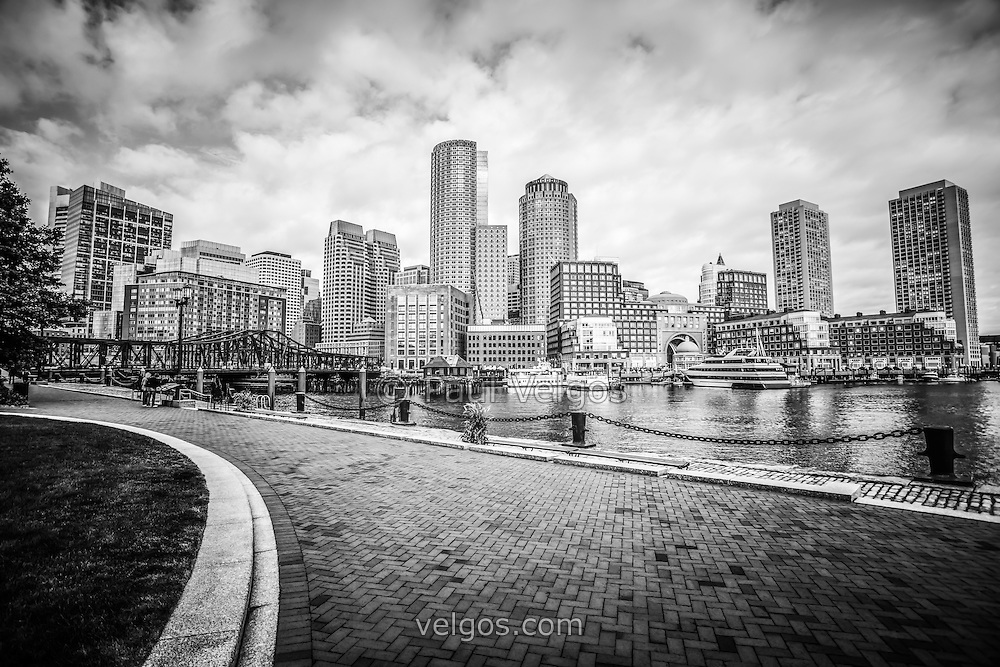 Boston skyline harborwalk black and white picture with rowes wharf downtown boston skyscrapers and nothern