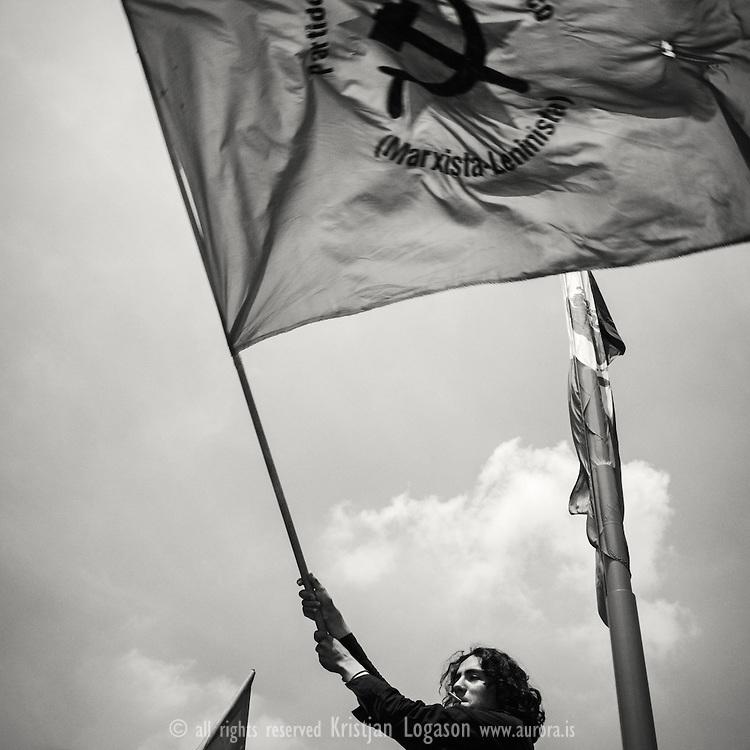 Members of the comunist party in Mexico city wave the red flag at the Zocalo square (plaza de la constitucion)