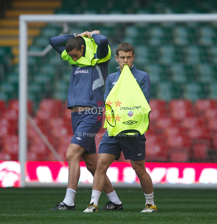 CARDIFF, WALES - Friday, March 25, 2011: England's Andy Carroll and Jack Wilshere during a training session at the Millennium Stadium ahead of the UEFA Euro 2012 qualifying Group G match against England. (Photo by David Rawcliffe/Propaganda)