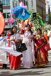 &copy; Licensed to London News Pictures. 14/05/2017. LONDON, UK. <br /> Performers dance in the street during the Boishakhi Mela street parade festival along and around Brick Lane in east London to celebrate the Bengali New Year. The Boishakhi Mela in Tower Hamlets is the largest celebration of Bengali New Year in Europe, attracting performers and crowds of thousands of spectators from around the world. Photo credit: Vickie Flores/LNP