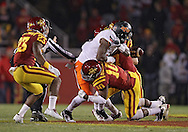 November 18, 2011: Oklahoma State Cowboys running back Joseph Randle (1) fumbles the ball as he is hit by Iowa State Cyclones defensive back Jacques Washington (10) during the first half of the NCAA football game between the Oklahoma State Cowboys and the Iowa State Cyclones at Jack Trice Stadium in Ames, Iowa on Friday, November 18, 2011. At halftime Oklahoma State was leading Iowa State 17-7.