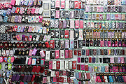 Mobile phone covers for sale in the Yiwu Small Commodity Market, the world's largest wholesalers market selling more than 17 million kinds of commodities that are exported all over the globe. More than 200 metric tones of goods are exported from Yiwu every day.