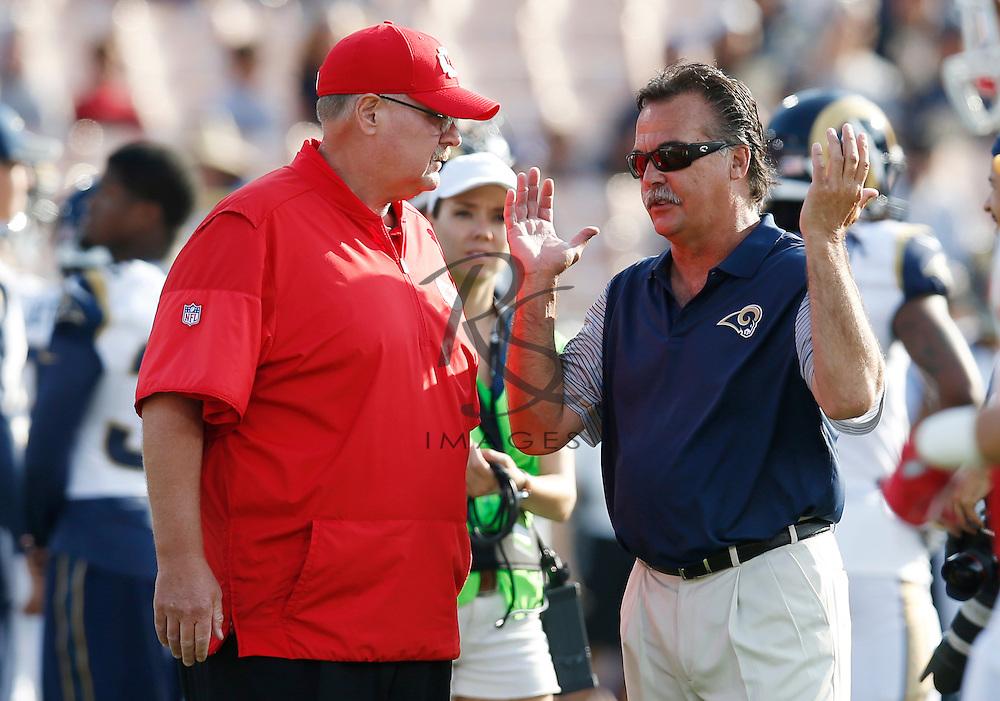 Kansas City Chiefs head coach Andy Reid, left, talks with Los Angeles Rams head coach Jeff Fisher prior to a preseason NFL football game, Saturday, Aug. 20, 2016, in Los Angeles. (AP Photo/Rick Scuteri)