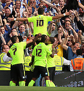 Tomer Hemed celebrating scoring a penalty in front of fans during the Sky Bet Championship match between Fulham and Brighton and Hove Albion at Craven Cottage, London, England on 15 August 2015. Photo by Matthew Redman.