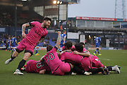 Southend United striker Nile Ranger (50) celebrates scoring the opening goal of the game to make the score 1-0 under a pile of his team mates during the EFL Sky Bet League 1 match between Oldham Athletic and Southend United at Boundary Park, Oldham, England on 17 December 2016. Photo by Simon Brady.