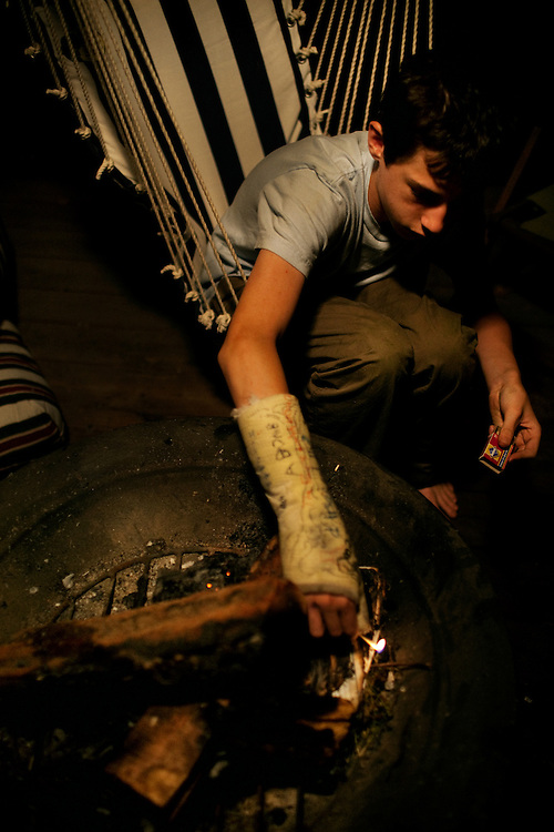 Peter Eich, 13, lights a fire on the deck of his parent's house in Chesapeake, Virginia.