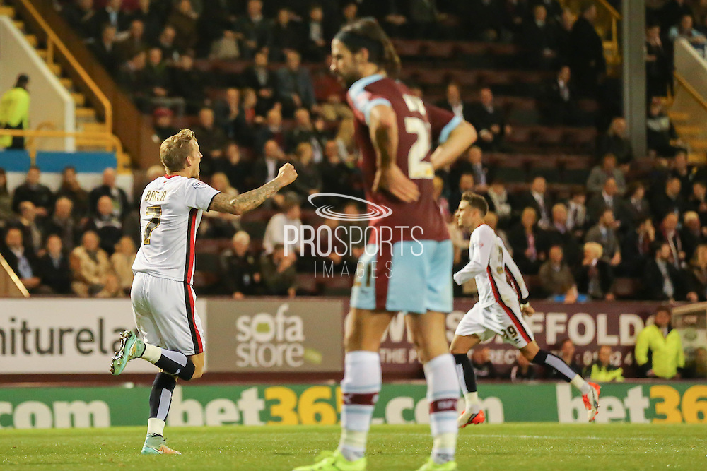Milton Keynes Dons midfielder Carl Baker celebrates the equaliser  during the Sky Bet Championship match between Burnley and Milton Keynes Dons at Turf Moor, Burnley, England on 15 September 2015. Photo by Simon Davies.