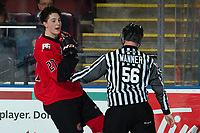 KELOWNA, BC - DECEMBER 30:  Rhett Rhinehart #27 of the Prince George Cougars argues with the referee as he skates to the penalty box with line official Cody Wanner against the Kelowna Rockets at Prospera Place on December 30, 2019 in Kelowna, Canada. (Photo by Marissa Baecker/Shoot the Breeze)