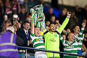 Celtic midfielder Scott Brown (#8) and Celtic goalkeeper Craig Gordon (#1) lift the Betfred Cup following a 3-0 win over Aberdeen in the Scottish Cup final match between Aberdeen and Celtic at Hampden Park, Glasgow, United Kingdom on 27 November 2016. Photo by Craig Doyle.