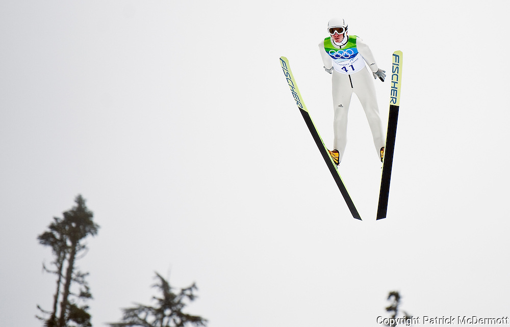 Michael Uhrmann of Germany flies through the air in the Men's Ski Jumping Normal Hill during the 2010 Vancouver Winter Olympics at the Whistler Olympic Park in Whistler, Canada, on Feb. 13, 2010. Uhrmann finished in fifth place.