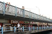 Balik ekmek (fish sandwich) and Efes beer on Galata Bridge Istanbul