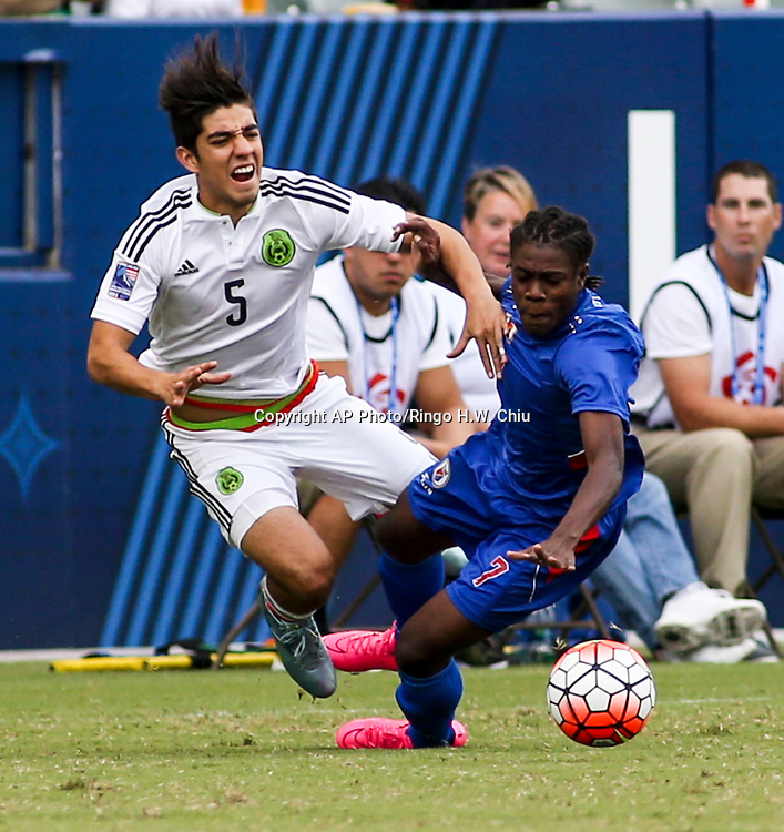 Mexico defender Rodolfo Gilbert Pizarro Thomas #5 and Haiti midfielder Jhon Miky Benchy Estama #7 fights for the ball in the first half of a CONCACAF men's Olympic qualifying soccer match in Carson, Calif., Sunday, Oct. 4, 2015. (AP Photo/Ringo H.W. Chiu)