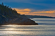 Storm light on Chedabucto Bay at sunset, Fox Island, Nova Scotia, Canada