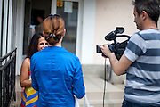 """Paralegal Romina Kajtazova being interviewed by the local television in Delcevo before a meeting with the institutions about """"Patients Rights of the Roma"""" in a restaurant in Delcevo, Macedonia."""