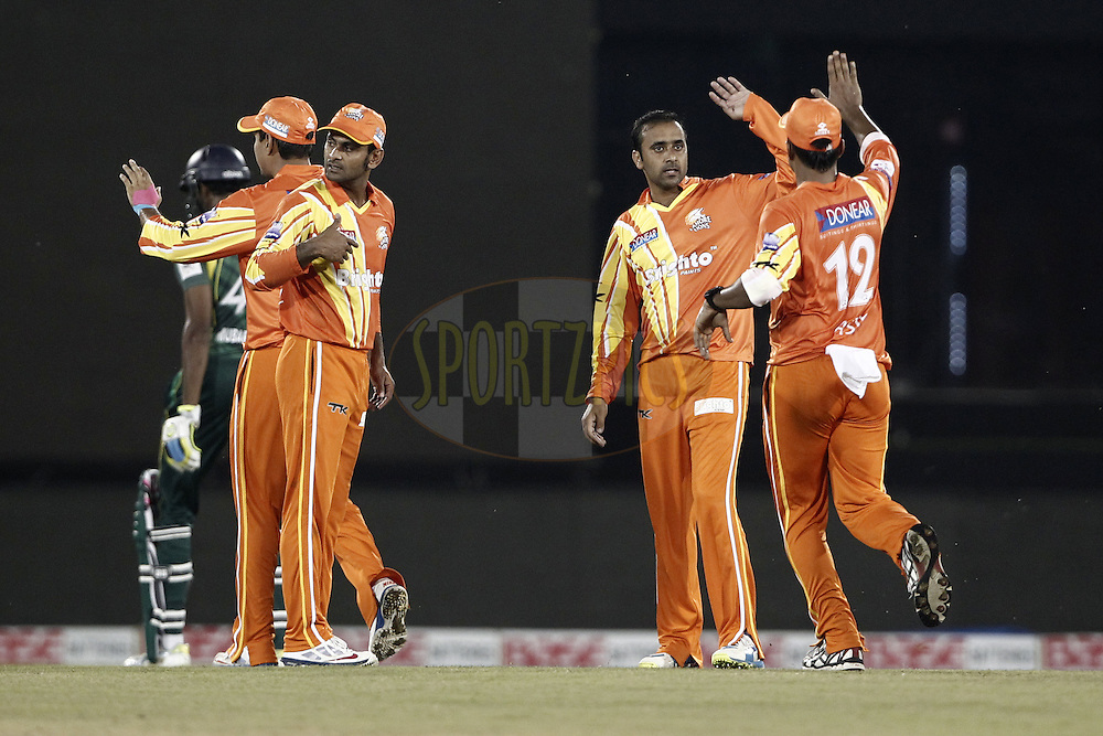 Adnan Rasool of the LAHORE LIONS celebrates the wicket of Jehan Mubarak Captain of the SOUTHERN EXPRESS during the qualifier 5 match of the Oppo Champions League Twenty20 between the Southern Express and the Lahore Lions held at the Chhattisgarh International Cricket Stadium, Raipur, India on the 16th September 2014<br /> <br /> Photo by:  Deepak Malik / Sportzpics/ CLT20<br /> <br /> <br /> Image use is subject to the terms and conditions as laid out by the BCCI/ CLT20.  The terms and conditions can be downloaded here:<br /> <br /> http://sportzpics.photoshelter.com/gallery/CLT20-Image-Terms-and-Conditions-2014/G0000IfNJn535VPU/C0000QhhKadWcjYs