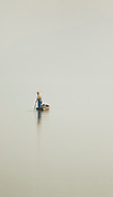 Chinese fisherman on a boat in foggy weather, hard to tell apart water and sky