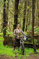 Mountain biking on a wet day along the Oregon Coast. Nehalem, OR