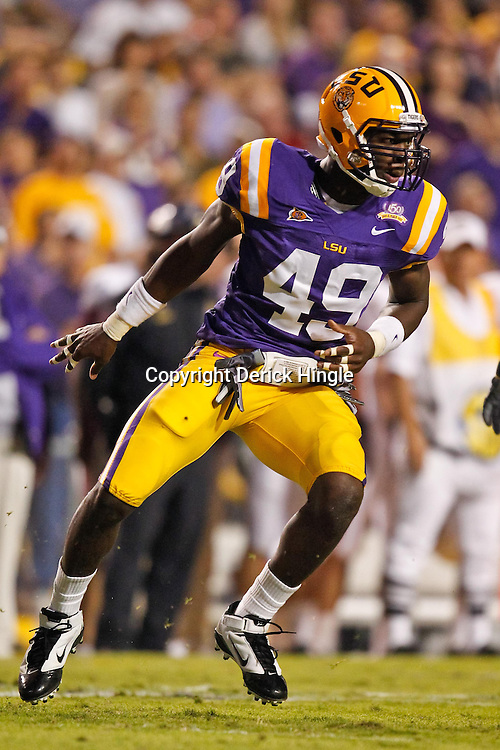 November 13, 2010; Baton Rouge, LA, USA; LSU Tigers defensive end Barkevious Mingo (49) pursues a play during the first half against the Louisiana Monroe Warhawks at Tiger Stadium.  Mandatory Credit: Derick E. Hingle