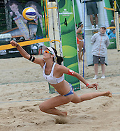 STARE JABLONKI POLAND - July 1:   Joana Heidrich /2/ of Switzerland in action during Day 1 of the FIVB Beach Volleyball World Championships on July 1, 2013 in Stare Jablonki Poland.  (Photo by Piotr Hawalej)