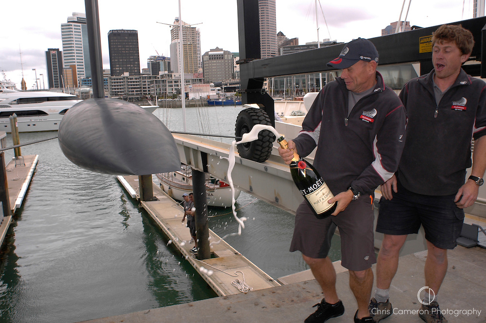 Emirates Team New Zealand head, Grant Dalton sprays Champagne over the bulb to launch GER68 at the the ETNZ base in Auckland..The GER68 hull was biult by Illbruck for the 2003 cup and completed by ETNZ for their testing program. 9/12/2004