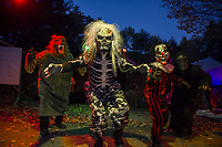 "Walter Waring ""Wolf"", Stephen Gibbs ""Skeleton"", Broderick Edwards ""Clown"" and Jacob Brown ""Ghoul"" are ready to great visitors at the Haunted House in Hill.  (Karen Bobotas/for the Laconia Daily Sun)"