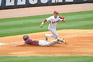 Mississippi State's Hunter Renfroe  slides safely into third in front of Arkansas' Matt Reynolds in the SEC Tournament at Regions Park in Hoover, Ala. on Tuesday, May 22, 2012.
