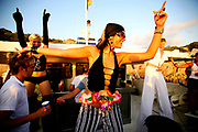 A happy woman dancing on a boat party, Ibiza 2005