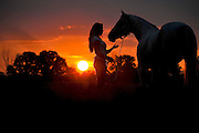 DETROIT, MICHIGAN - USA - A girl with her horse at sunset portrait. (Photo by Bryan Mitchell)