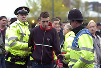Photo. Jed Wee.<br /> Manchester United v Charlton Atheltic, FA Barclaycard Premiership, 20/04/2004.<br /> Security fears amidst terrorism raids in Manchester sees stepped up security at Old Trafford, as police take the cautious route and apprehend a young man outside the ground.