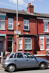 © Licensed to London News Pictures. 23/07/2012. Manchester , UK . General view of 64 Acomb Street , believed to be the home address of the two girls who went missing overnight . Police have said that the two sisters Liana Boyd , 11 and Teigan Boyd , 8 , who went missing at about 8pm last night (22nd July) when they went to play in Whitworth Park , close to their home , have since been found . Photo credit : Joel Goodman/LNP