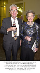 MR & MRS JOHN COLE, he is the political reporter, at a party in London on 20th March 2002.OYN 7