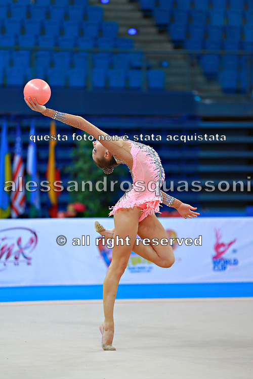 Staniouta Melitina during qualifying at ball in Pesaro World Cup April 10, 2015. Melitina is an Belarusian rhythmic gymnast, she was born in November 15, 1993 in Minsk. She is a three time World All-around bronze medalist in 2015, 2013, 2010 retired from rhythmic gymnastics in December 2016.