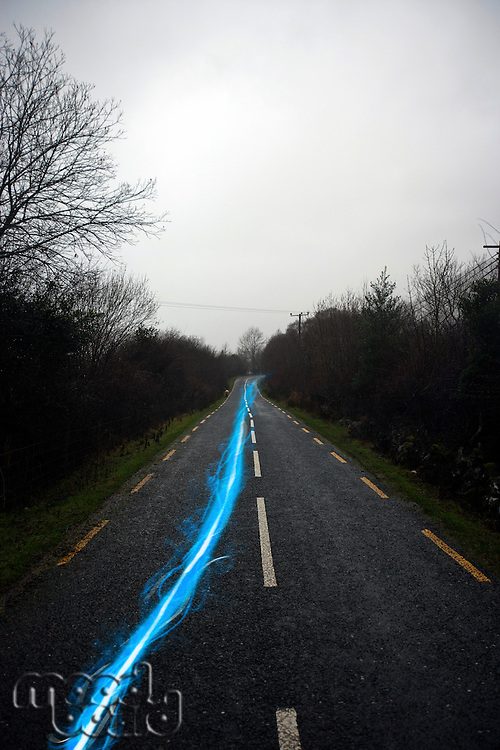Blue streak of light on country road