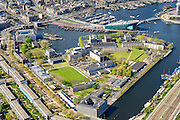 Nederland, Noord-Holland, Amsterdam, 09-04-2014;<br /> Nederland, Noord-Holland, Amsterdam, 09-04-2014;<br /> Marineterrein en Kattenburg, Scheepvaartmuseum, de IJtunnel en museum Nemo met historische woonboten. <br /> Rechts de Dijksgracht en het spoor.<br /> Navy area and the National Maritime Museum (white building), right Museum Nemo.<br /> luchtfoto (toeslag op standard tarieven);<br /> aerial photo (additional fee required);<br /> copyright foto/photo Siebe Swart