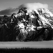 Mount Moran at Sunrise with clearing storm and valley fog in Grand Teton National Park, Wyoming.