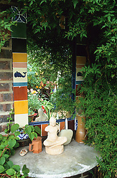 Mirror and ornaments on a shady wall