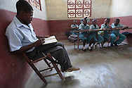 Various grade levels attend school at the Church of Christ school in Saint Roch mountain above Carrefour, Haiti.  The classes are conducted in a concrete building with a concrete floor.  The 6th grade is conducted in the church.