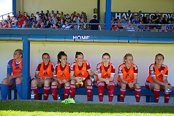 HAVERFORDWEST, WALES - Saturday, June 14, 2014: Wales' substitutes on the bench before the FIFA Women's World Cup Canada 2015 Qualifying Group 6 match against Turkey at the Bridge Meadow Stadium. goalkeeper Sophie Dando, Rhian Cleverley, Georgia Evans, Carys Hawkins, Michelle Green, Nadia Lawrence, Josephine Green. (Pic by David Rawcliffe/Propaganda)