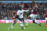 Aston Villa striker(on loan from Chelsea) Tammy Abraham (18) comes in to tackle Derby County defender (on loan from Chelsea) Fikayo Tomori (5) with Aston Villa forward Andre Green (19) during the EFL Sky Bet Championship match between Aston Villa and Derby County at Villa Park, Birmingham, England on 2 March 2019.