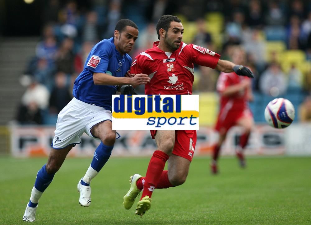 Photo: Rich Eaton.<br /> <br /> Millwall v Swindon Town. Coca Cola League 1. 29/09/2007. Millwall's Danny Senda (L) and Swindon's Sofiene Zaaboub (R) go for the ball.
